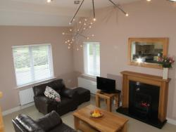 kilmuckridge-holiday-homes-wexford-luxury-self-catering-living-space-family-room (19)
